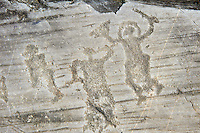 Petroglyph, rock carving, of two warriors one wearing a helmet and carrying a sword and shield. Carved by the ancient Camuni people in the iron age between 1000-1600 BC. Rock no 24,  Foppi di Nadro, Riserva Naturale Incisioni Rupestri di Ceto, Cimbergo e Paspardo, Capo di Ponti, Valcamonica (Val Camonica), Lombardy plain, Italy