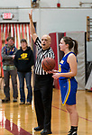 WINSTED,  CT-021119JS29- Basketball referee Edward Alicea hands the ball to Housatonic's Madelynn Olownia (25) as works the game between Northwester and Housatonic girls Monday at Northwestern Regional High School in Winsted. <br /> Jim Shannon Republican American