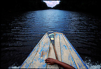 Amerindians travel by dugout or small wood power boats between communities.  This boat is owned by the town of Chenapow.