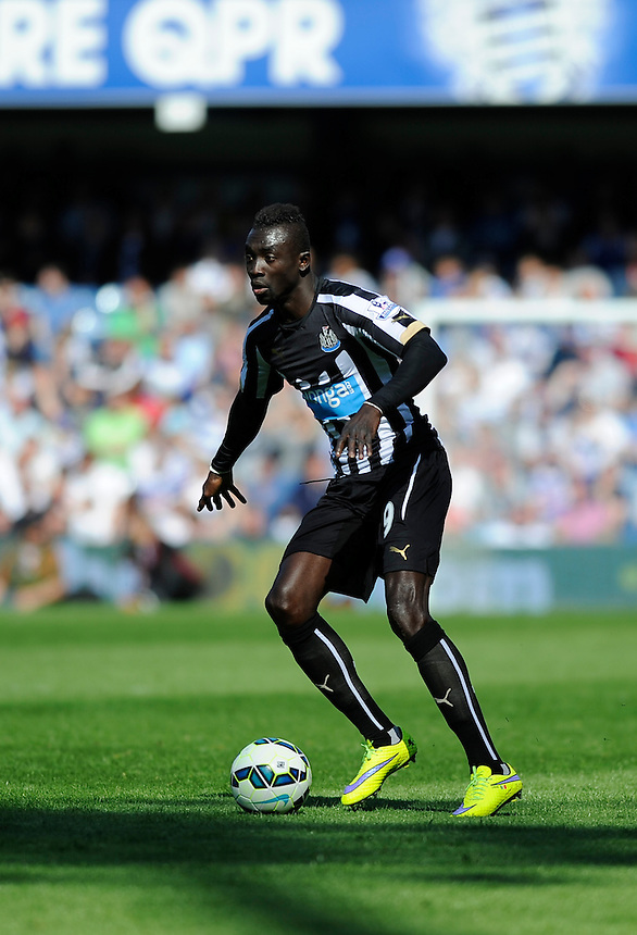 Newcastle United's Papiss Demba Cisse in action during todays match  <br /> <br /> Photographer Ashley Western/CameraSport<br /> <br /> Football - Barclays Premiership - Queens Park Rangers v Newcastle United - Saturday 16th May 2015 - Loftus Road - London<br /> <br /> &copy; CameraSport - 43 Linden Ave. Countesthorpe. Leicester. England. LE8 5PG - Tel: +44 (0) 116 277 4147 - admin@camerasport.com - www.camerasport.com