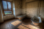 An abandoned palace in East Germany with old baths in tiled room