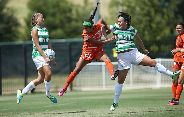 ARLINGTON, TX - AUGUST 25: Anna Flobeck #14 and Lynda Hercules #21 of the North Texas Mean Green - Houston Baptist vs North Texas Mean Green Soccer at Mean Green Village Soccer Field in Denton on August 25, 2013 in Denton, Texas. Photo by Rick Yeatts