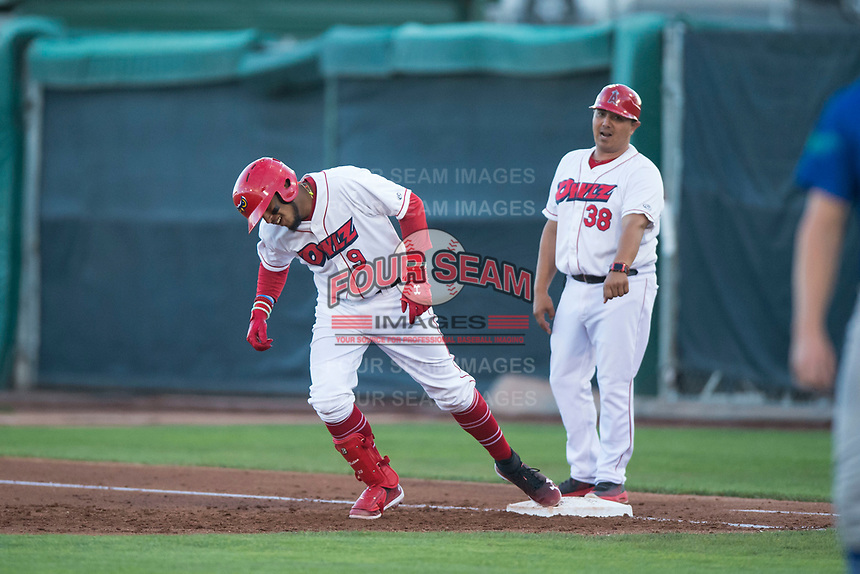 Orem Owlz third baseman Kevin Maitan (9) touches first base in front of coach Manny Del Campo (38) after hitting a home run during a Pioneer League game against the Ogden Raptors at Home of the OWLZ on August 24, 2018 in Orem, Utah. The Ogden Raptors defeated the Orem Owlz by a score of 13-5. (Zachary Lucy/Four Seam Images)