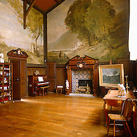 Huge landscape murals dominate the walls of the large, sumptuous 19th century Parisian atelier of Charles Francois Daubigny