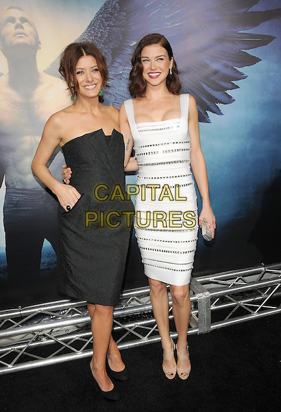 """KATE WALSH & ADRIANNE PALICKI.World Premiere of """"Legion"""" held at The Arclight Cinerama Dome in Hollywood, California, USA..January 21st, 2010.full length dress black strapless hand in pocket folded front origami pattern white cleavage silver striped stripes sequins sequined .CAP/RKE/DVS.©DVS/RockinExposures/Capital Pictures."""