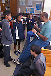 Berkeley, CA 5th grade teacher reprimanding student in class while others look on