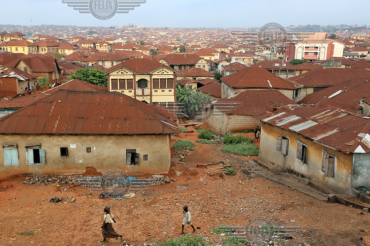 Rusting corrugated iron rooftops fill the housing landscape in Ibadan.