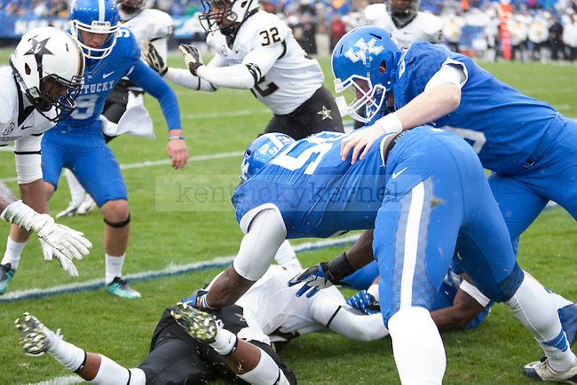 Mike Douglas, sophomore defensive line after a tackle during the first half of the UK vs. Vanderbilt football game at Commonwealth Stadium, Photo by Adam Chaffins