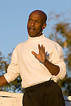 African American man gesturing, looking away from camera