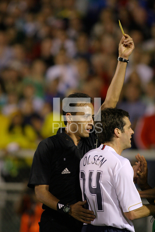 Referee Jorge Gasso Flores issues a yellow card to a Jamaican player after he tackled Ben Olsen. The USA tied Jamaica 1-1 at SAS Soccer Park in Cary, N.C. on April 11, 2006.