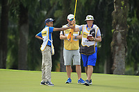 Three caddies on the 9th green during Round 2 of the Maybank Championship at the Saujana Golf and Country Club in Kuala Lumpur on Friday 2nd February 2018.<br /> Picture:  Thos Caffrey / www.golffile.ie<br /> <br /> All photo usage must carry mandatory copyright credit (&copy; Golffile | Thos Caffrey)