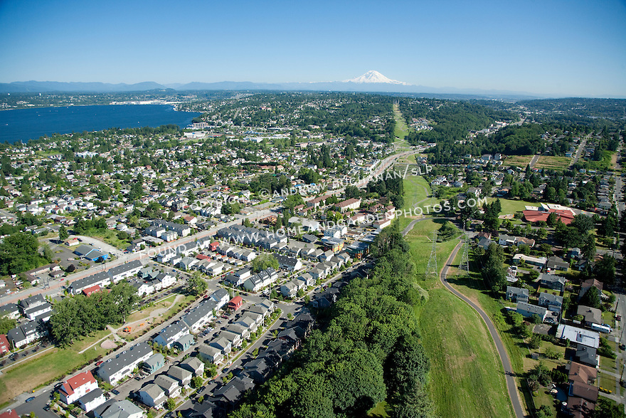 New Holly / Holly Park; Seattle, WA; An aerial view of New Holly, a mixed housing development in Seattle, with nearby SoundTransit light rail and Mt. Rainier in the background