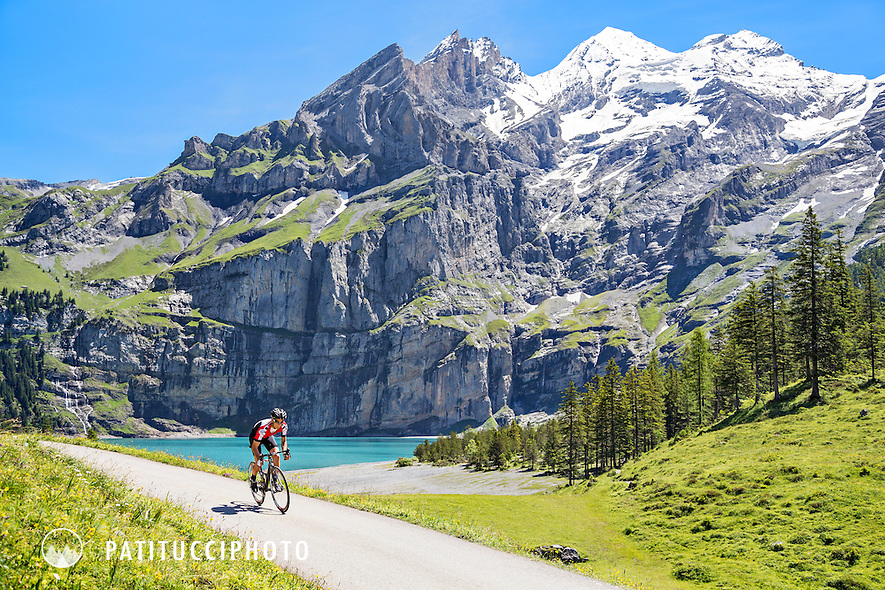 Male road biker cycling from Kandersteg on the road to Oeschinensee, in the Swiss Alps