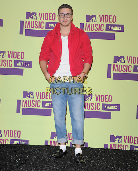Vinny Guadagnino.Pressroom at the 2012 MTV Video Music Awards held at Staples Center, Los Angeles, California, USA..September 6th, 2012.full length jacket jeans denim red white top glasses hands in pockets                                                                 .CAP/DVS.©DVS/Capital Pictures.