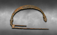 Phrygian bronze fibula from Gordion. Phrygian Collection, 8th-7th century BC - Museum of Anatolian Civilisations Ankara. Turkey. Against a grey background