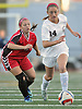 Garden City No. 14 Isabel Klatt (red head band), right, controls the ball under pressure during the first half of a Nassau County varsity girls' soccer Class A semifinal against Island Trees at Cold Spring Harbor High School on Friday, October 30, 2015. Klatt scored a goal early in the second half in Garden City's 2-0 win.<br /> <br /> James Escher