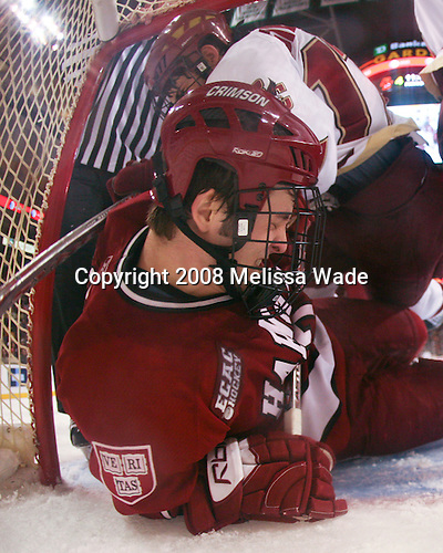 Brian Gibbons (BC 17) falls on Chad Morin (Harvard 7) who was already in the Harvard net. The Boston College Eagles defeated the Harvard University Crimson 6-5 in overtime on Monday, February 11, 2008, to win the 2008 Beanpot at the TD Banknorth Garden in Boston, Massachusetts.