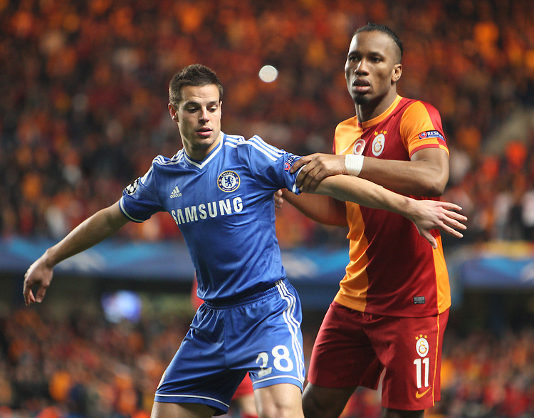 Chelsea's Cesar Azpilicueta despite the attentions of  Galatasaray's Didier Drogba<br /> <br /> Photo by Kieran Galvin/CameraSport<br /> <br /> Football - UEFA Champions League First Knockout Round 2nd Leg - Chelsea v Galatasaray - Tuesday 18th March 2014 - Stamford Bridge - London<br />  <br /> &copy; CameraSport - 43 Linden Ave. Countesthorpe. Leicester. England. LE8 5PG - Tel: +44 (0) 116 277 4147 - admin@camerasport.com - www.camerasport.com