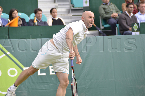 22.06.2013. Stoke park, Slouogh, berkshire, England. The Boodles Challenge mens doubles finals. Jamie Delgado of Great Britain and his American partner James Cerrentani versus the pairing of Adil Shamasolin and Rameez Junaid. Jamie Delgado serves
