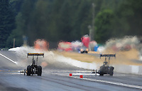 Aug. 7, 2011; Kent, WA, USA; NHRA top fuel dragster driver Troy Buff (left) races down track alongside Brandon Bernstein during the Northwest Nationals at Pacific Raceways. Mandatory Credit: Mark J. Rebilas-
