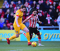 Lincoln City's Bruno Andrade under pressure from Northampton Town's Ash Taylor<br /> <br /> Photographer Andrew Vaughan/CameraSport<br /> <br /> The EFL Sky Bet League Two - Lincoln City v Northampton Town - Saturday 9th February 2019 - Sincil Bank - Lincoln<br /> <br /> World Copyright &copy; 2019 CameraSport. All rights reserved. 43 Linden Ave. Countesthorpe. Leicester. England. LE8 5PG - Tel: +44 (0) 116 277 4147 - admin@camerasport.com - www.camerasport.com