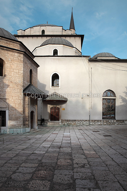 The Mausoleum of Gazi Husrev-beg, 1480-1541 (left), at the Gazi Husrev-beg Mosque, built 1530-32, Sarajevo, Bosnia and Herzegovina. The complex includes a maktab and madrasa (Islamic primary and secondary schools), a bezistan (vaulted marketplace)and a hammam. The mosque was renovated after damage during the 1992 Siege of Sarajevo during the Yugoslav War. Picture by Manuel Cohen