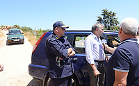 Pictured: Pathologist Nikos Karakoukis (R) speaks to members of the media in Ikaria, Greece. Thursday 08 August 2019<br /> Re: Rescuers searching for  British scientist Natalie Christopher, 35, who disappeared on the  island of Ikaria, Greece have found her body at the bottom of a ravine.<br /> She was found less than a mile from the hotel in the Kerame area where she was on holiday with her Cypriot partner.<br /> Emergency service staff said that a large rock had dislodged as she fell, causing multiple head injuries.<br /> The woman's body will be kept overnight at the spot so a coroner can examine it on Thursday morning.