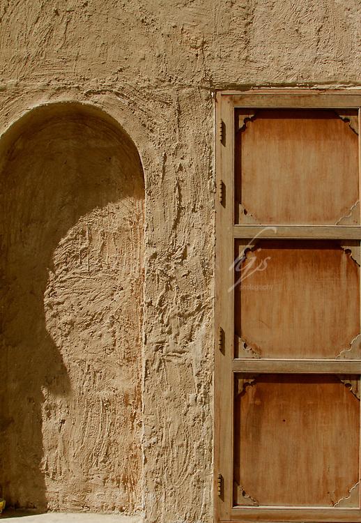 Wood vs Stone, curve vs straight, cold vs warm texture, Souq Waqif, Doha, Qatar | Mar10