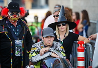 Oct 29, 2016; Las Vegas, NV, USA; NHRA pro stock motorcycle rider Gunner Courtney with crew members dressed in Halloween costumes during qualifying for the Toyota Nationals at The Strip at Las Vegas Motor Speedway. Mandatory Credit: Mark J. Rebilas-USA TODAY Sports