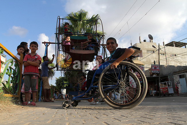 Palestinian children enjoy a ride at an amusement park during the second day of Eid al-Adha or the feast of sacrifice, in Rafah in the southern of Gaza strip, on Sep. 13, 2016. Muslims across the world are celebrating the annual festival of Eid al-Adha, or the Festival of Sacrifice, which marks the end of the Hajj pilgrimage to Mecca and in commemoration of Prophet Abraham's readiness to sacrifice his son to show obedience to God. Photo by Abed Rahim Khatib