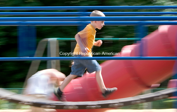 PROSPECT, CT- 29 JUNE 2007- 062907JT01-<br /> Joshua Rucevice, 5, of Waterbury, runs over a bridge at a playground at Hotchkiss field in Prospect on Friday afternoon.<br /> Josalee Thrift Republican-American