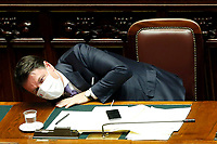 The Italian premier Giuseppe Conte looking for an electric socket under the table, to recharge his phone, during his speech about the European Council at the Chamber of Deputies. Rome (Italy), July 22nd 2020<br /> Foto Samantha Zucchi Insidefoto