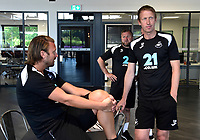 (L-R) Bjorn Hamberg, assistant coach Billy Reid, assistant manager and manager Graham Potter during the Swansea City Players Return to Pre-Season Training at The Fairwood Training Ground, Wales, UK. Monday 02 July 2018