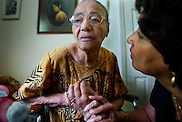 During a moment of confusion, Alma Brown, right, tries to comfort her mother Allie May Richards, 94, who is suffering with Alzheimer's Disease as she visits her at The Arbors Assisted Living Facility in Ormond Beach Monday May 5, 2003. Photographs of Allie May as a young woman hang on her bedroom wall in the background, a long way from where her disease has taken her as she struggles to remember even her daughter who visits her everyday.(Kelly Jordan)..**FOR JEANNINE STORY 5/11**