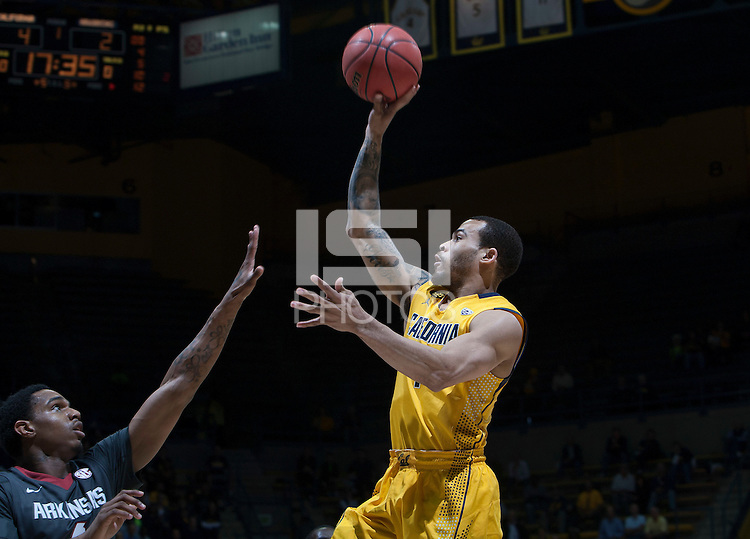 Justin Cobbs of California shoots the ball during 2014 National Invitation Tournament against Arkansas at Haas Pavilion in Berkeley, California on March 24th, 2014.  California defeated Arkansas, 75-64.