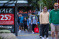 The queue for Chaffers New World Supermarket during lockdown for COVID19 pandemic in Wellington, New Zealand on Thursday, 9 April 2020. Photo: Dave Lintott / lintottphoto.co.nz