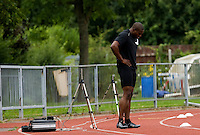 29 JUL 2008 - LOUGHBOROUGH, UK - Harry Aikines Aryeetey rests during the Team GB 4x100m practise - Beijing bound Loughborough students, graduates and staff and, Team GB 4x100m Relay team training. (PHOTO (C) NIGEL FARROW)