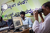 During national identity enrolment, a resident is seen having his iris scanned in Mysore city in Karnataka. Photograph: Sanjit Das/Panos