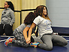 Kathy Rosado, Copiague High School junior, right, practices wrestling holds with classmate Yafreycy Taveras at Copiague High School on Tuesday, Jan. 31, 2017.