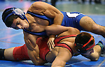 Carson's Anthony Estrada and Lincoln's Jorge Robles compete at the annual Sierra Nevada Classic wrestling tournament in Reno, Nev., on Thursday, Dec. 27, 2013. <br /> Photo by Cathleen Allison