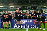 Saracens skipper Joel Conlon lifts the Premiership Rugby 7s trophy as his team-mates celebrate. Premiership Rugby 7s (Day 2) on July 28, 2018 at Franklin's Gardens in Northampton, England. Photo by: Patrick Khachfe / Onside Images