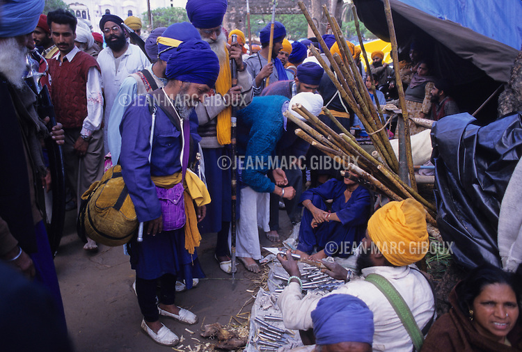 For the past 300 years the Nihangs, Holy warriors of Sikhism gather at the foothills of the Himalayas in Punjab to celebrate the Hola Mohalla,  the creation of the Sikh Army by Guru Gobind Singh to defend the Sikh homeland from the invading Mughal armies. Dressed in their traditional blue colors, they arrive barring their weapons  in Anandpur Sahib, demonstrating their prowess in martial arts and horse riding. Duels take place everywhere, while others prepare the 'Nectar', a cannabis-laced drink that they distribute freely. Pilgrims arrive at one of Anandpur Sahib to celebrate the Hola Mohalla with the Nihangs, for prayers, trade and festivities. (Photo by Jean-Marc Giboux)