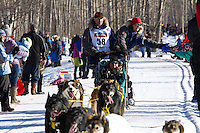 Hans Gatt and team run past spectators on the bike/ski trail during the Anchorage ceremonial start during the 2014 Iditarod race.<br /> Photo by Britt Coon/IditarodPhotos.com