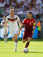 Christian Ronaldo of Portugal and Per Mertesacker of Germany