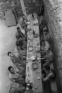 "Mascara Area, Algeria, Summer 1961. Typical French Fort for a small harka unit. This unit counted 48 ""harkis"", Arab origin, fighting along the French troops. Harkis during lunch time."