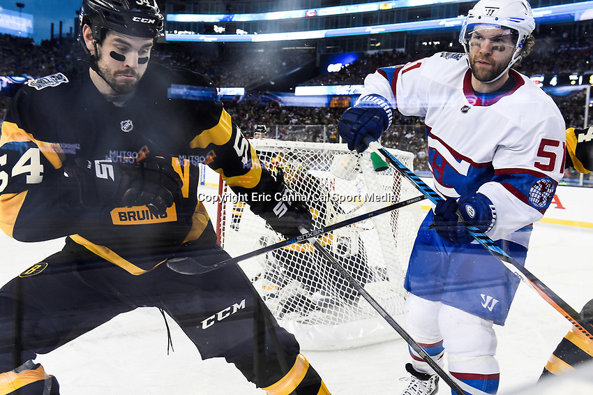 Friday January 1, 2016: Boston Bruins defenseman Adam McQuaid (54) and Montreal Canadiens center David Desharnais (51) in game action during the National Hockey League Bridgestone Winter Classic game between the Montreal Canadiens and the Boston Bruins, held at Gillette Stadium in Foxborough, Massachusetts. Montreal defeats Boston 5-1 in regulation time. Eric Canha/CSM
