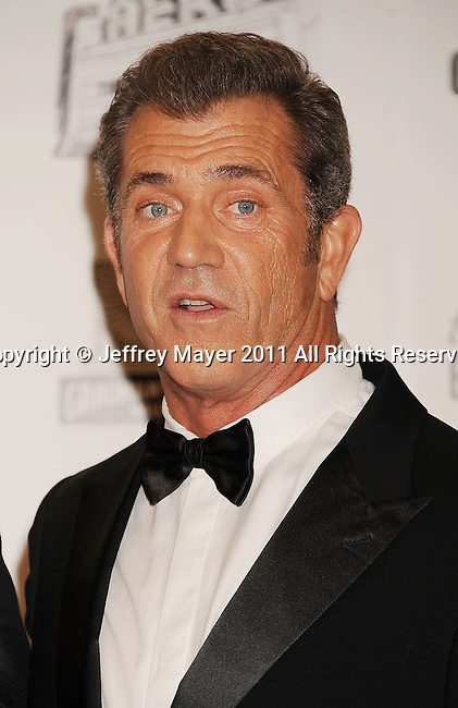 BEVERLY HILLS, CA - OCTOBER 14: Mel Gibson  poses during the The 25th American Cinematheque Award Honoring Robert Downey Jr. at The Beverly Hilton hotel on October 14, 2011 in Beverly Hills, California.