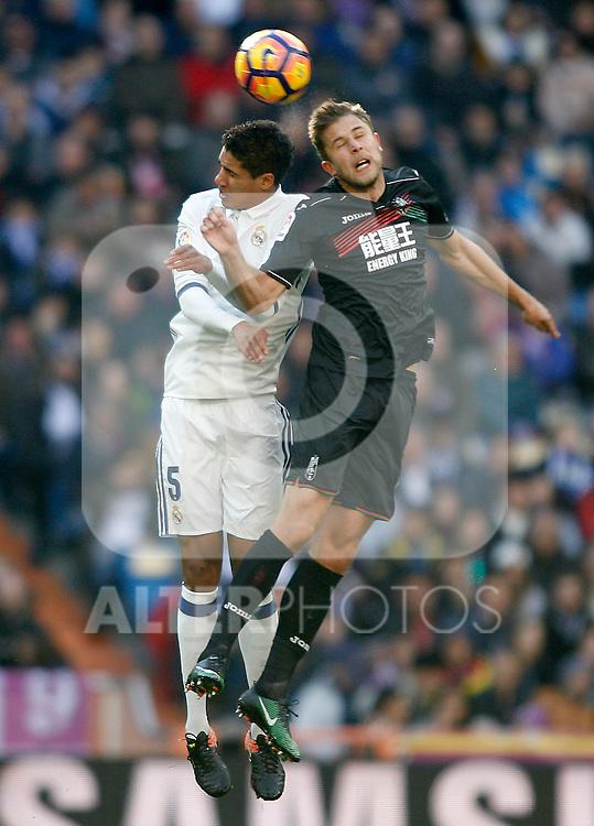 Real Madrid's Raphael Varane (l) and Granada CF's Artem Kravets during La Liga match. January 7,2016. (ALTERPHOTOS/Acero)