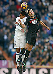 Real Madrid's Raphael Varane (l) and Granada CF's Artem Kravets during La Liga match. January 7,2016. (ALTERPHOTOS/Acero)