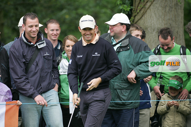 Padraig Harrington has a laugh with the crowd as a young supporter asks for a ball on the 4th hole during the 3rd round of the BMW PGA Championship at Wentworth Club, Surrey, England 26th may 2007 (Photo by Eoin Clarke/NEWSFILE)